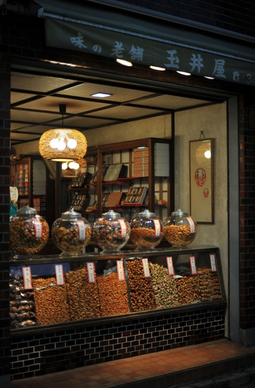 If I ever had a chance to open a small shop (may it be candy, ice cream or baked goods), this would be a great design - instead of a shop window, have a 'counter'