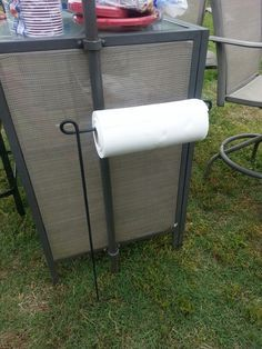Use a garden flag holder for paper towels for those backyard barbecues..