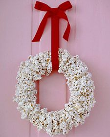 Popcorn wreath   1. Cut the center out of a paper plate. 2. Cut a 3-foot length of waxed dental floss; tie one end to plate. 3. Thread other end through needle, and string popcorn. 4. Wrap strand around plate; tie off. 5. Add strands until wreath is covered (layer to fill gaps). 6. Loop ribbon and hang; glue on a bow.
