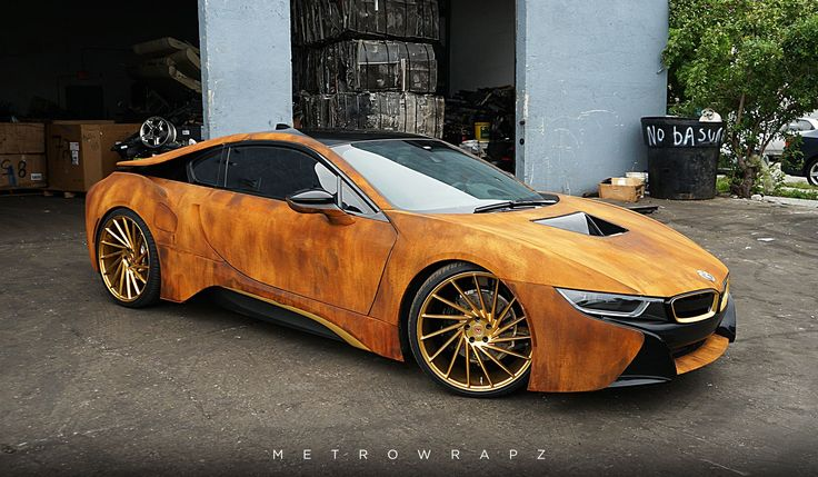 A recently wrapped BMW i8 by MetroWrapz with a rust themed design as well as a set of Vossen Wheels