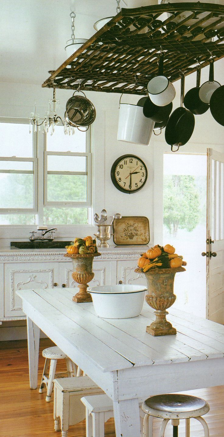 white kitchen island + pot rack from old gate