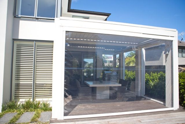 Louvretec Opening Roof with clear PVC blinds closed - creating the ultimate outdoor room