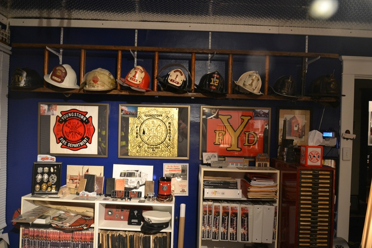Old ladders can be used to display helmets or other fire related items. Photo of part of Greg Ricker, webmaster of youngstownfire.com's  fire room.