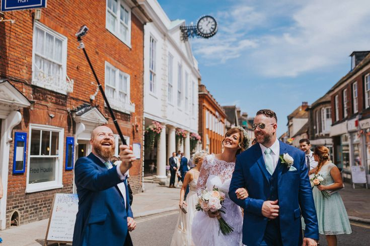 GoPro on a selfie stick? Sure, why not! Quick pic of the happy couple walking down Hythe High Street. Photo by Benjamin Stuart Photography #weddingphotography #selfie #gopro #selfiestick #brideandgroom #hythe #weddingday