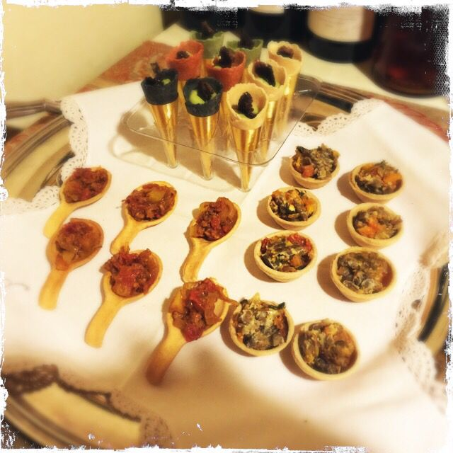 South African canapés - bobotie in a tart shell, Durban bunny chow on a spoon shell and avo with biltong in a cone shell.