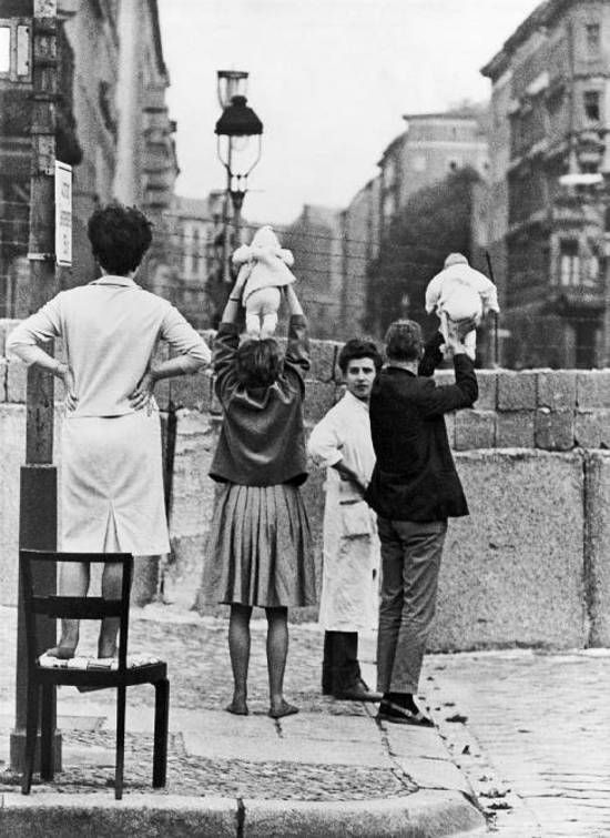 residents of west berlin show children to their on berlin wall id=12781