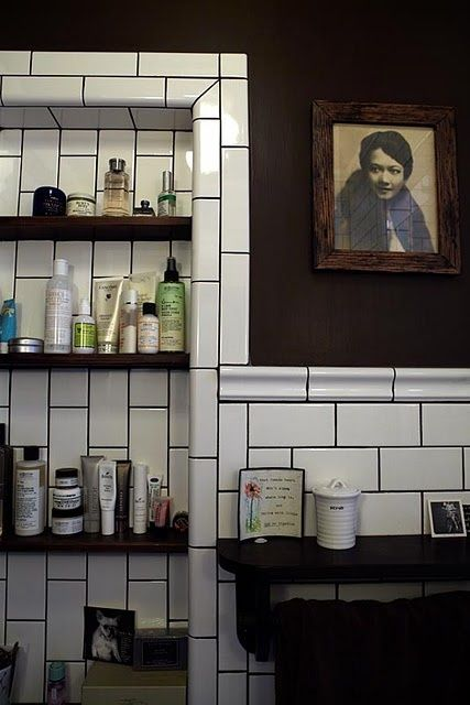 Love the wall color and the dark grout and the vintage photo.  via Bungalow Blue Interiors - Home - white subway tile + dark grout