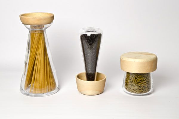 """Transparent concave shapes made of mouth-blown glass dedicated to the three different shape of pasta: 'long', 'short' and 'petite'. The flared neck of the container allows you to easily remove the desired amount of spaghetti, while the cap holds garlic and chili. The concave shapes cap for 'short' pasta can be used to weigh pens and butterflies; """"petite"""" is instead placed upside down on the floor making it able to dose rice and pasta. www.studiolievito.com"""