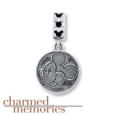 This dangle charm from Charmed Memories® features the face of Mickey Mouse in a sterling silver circle. ©Disney