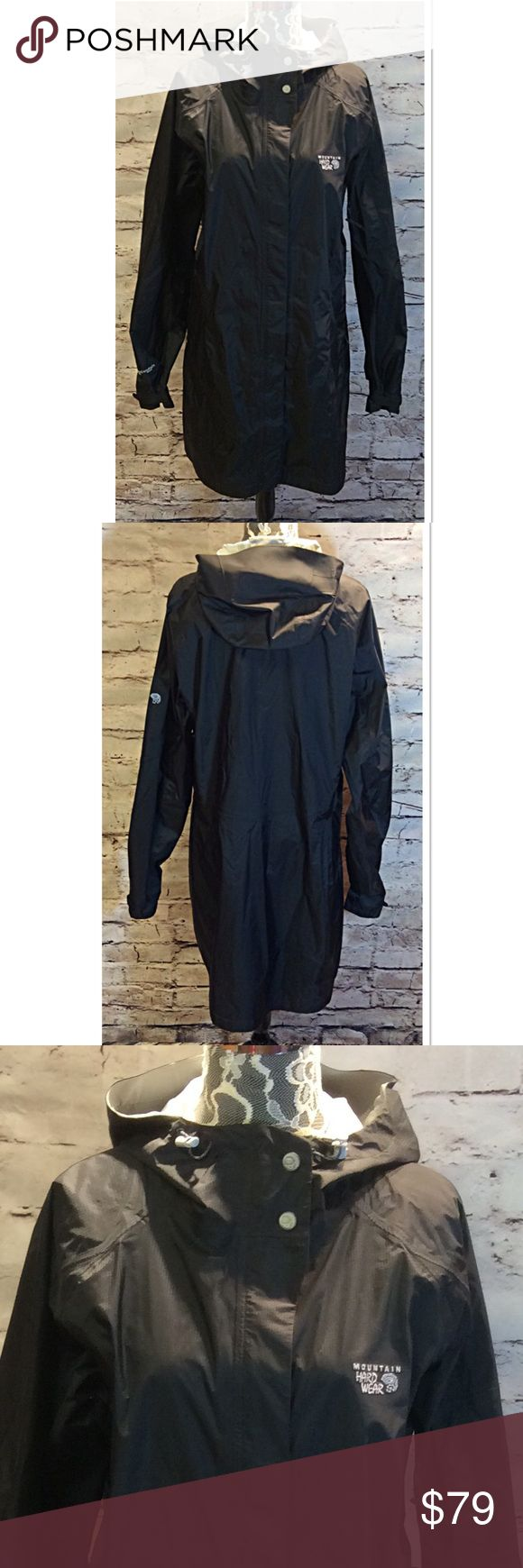 XL MOUNTAIN HARD WEAR BLACK LONG RAIN JACKET Awesome rain parka that's lightweight with a tuck away hood and zip pockets on the sides and arm. Zip and Velcro closure with bungee pulls to tight the hood to a snug fit. Like new Mountain Hard Wear Jackets & Coats Trench Coats