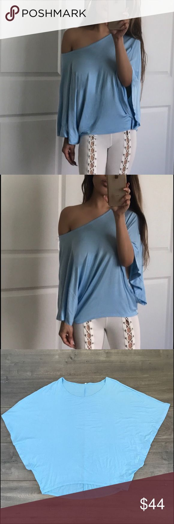 "🆕 ""ATHENS"" Dolman Batwing Top 💛✨Feminine beauty...a loose fit dolman batwing sleeve top...Smooth and slinky...gorgeous ""Crystal blue"" color in 95% rayon 5% spandex. *Medium measures 33"" chest/ 25.5"" hem front/ 27.5"" hem back. I'm modeling small. ✨ boutique Tops Tunics"