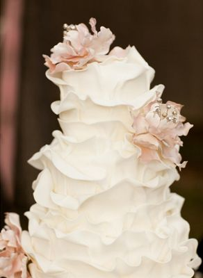 Idea: amp up the whimsy, and have your cake channel the blooming petals of a flower instead.