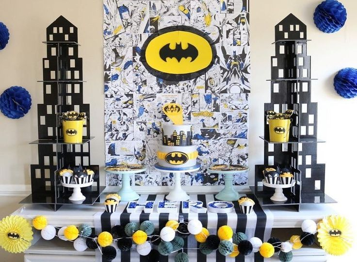 POW BANG POP! This Batman themed party from @sweetlychicevents is everything a little caped crusader would want!  See all the details click the link. #batman #batmanpartyideas #birthdaypartyideas #superheropartyideas #boybirthday #girlbirthday #orientaltrading