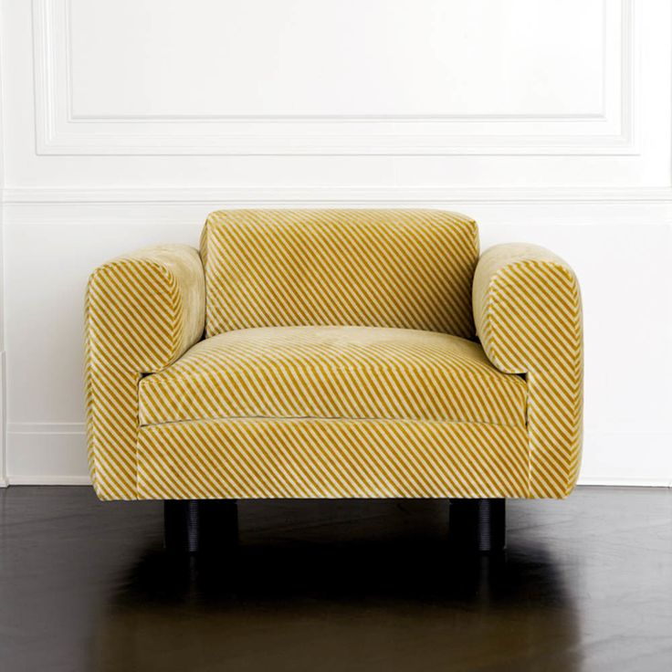 KELLY WEARSTLER | DURANT CLUB CHAIR. Ebony oak and upholstered in Oblique Gold