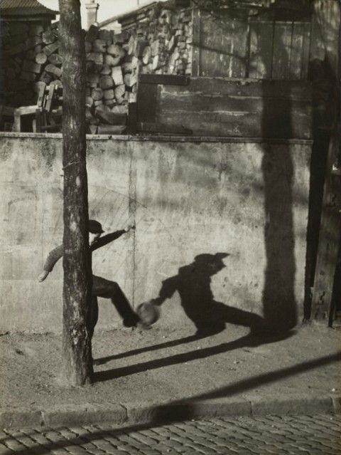André Kertész Child kicking ball c.1930