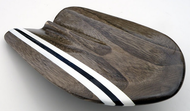 Brownfish handplane for bodysurfing.