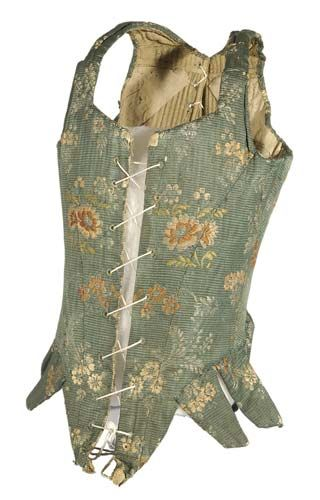 Date:1750 - 1799 (c.)    Description: A pair of women's stays from the second half of the 18th century. Stays were the predecesser to the corset and were worn as a supporting undergarment. This pair has a linen lining with a silk front decorated with a floral design. They were worn over a cotton chemise and under the dress or gown. Whalebone was used to stiffen the stays which were laced up both at the front and the back.   During the eighteenth century staymakers were usually men, due to…