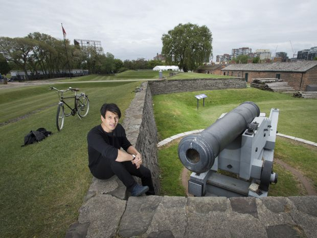 Arts and Craft's Field Trip Festival founder Jeffrey Remedios sits at Toronto's Fort York,