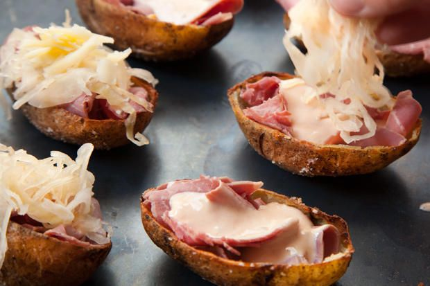 Corned beef, sauerkraut, and melted cheese in crispy potato skins.