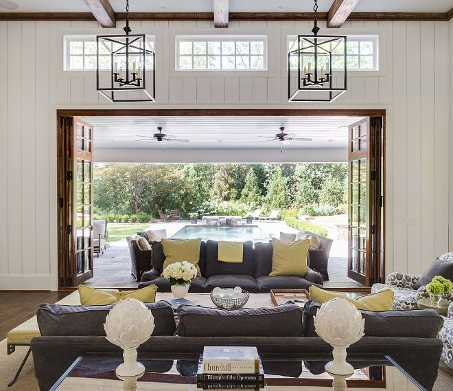 Living room doors. The best part of the living room is how it opens up to the outdoor area with custom folding doors. By opening the family room to the outdoors, it creates a great entertaining space with a lovely view of the pool. #livingroom #doors Interiors by Courtney Dickey. Architecture by T.S. Adam Studio.