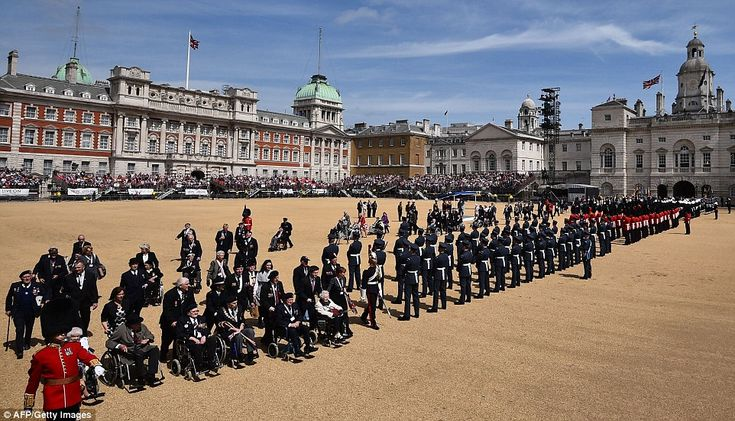 Members of the armed forces and veterans muster on Horse Guards Parade during the parade t...