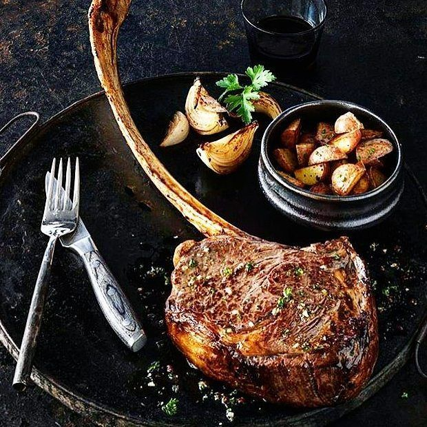 Incredible. Cowboy-cut. Garlic & Herb-encrusted. Tomahawk ribeye steak with fire-roasted  potatoes and caramelized shallots. #likeaboss #myfoodeatsyourfood  . Courtesy: Allen Brothers Steaks | @absteaks  #chef #grill #grilling #bbq #barbecue #parrilla #asado #backyardbbqhero #beef #beefitswhatsfordinner #beer #prime #meat #meatlover #carnivore #paleo #glutenfree #feast #instagood #foodstagram #foodgasm #foodpics #steak #steakporn #getinmybelly #beautifulcuisines #firemakeseverythingbetter