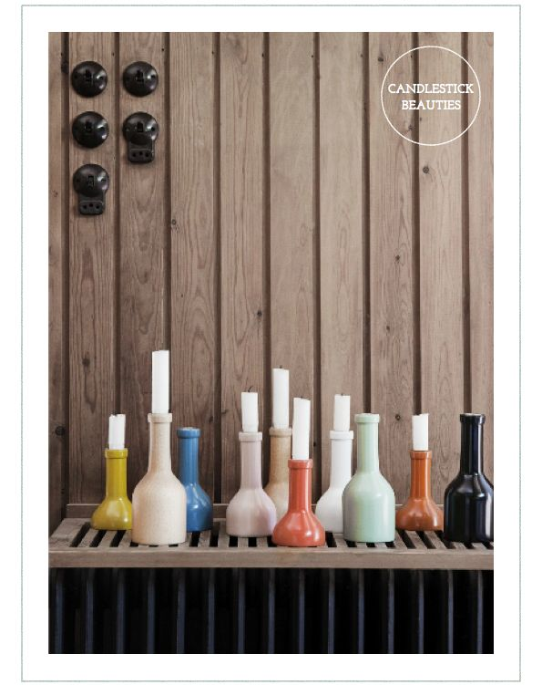 Cut wine bottles in half, spray paint and you've got yourself a candlestick holder!