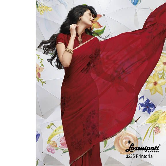Heart melting red color makes the saree most dashing ever... with studded diamonds & golden border lace.