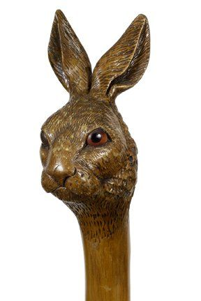 Folk-Art Rabbit Cane-Ca. 1885-A very nicely carved one piece rabbit cane with two color glass eyes and a metal ferrule.