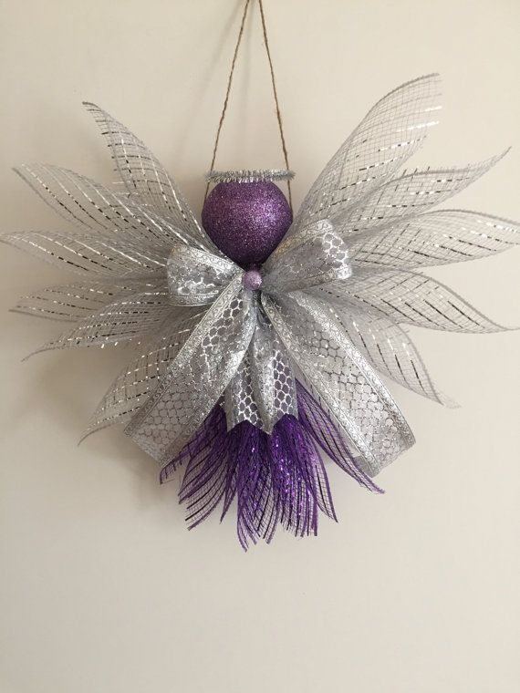Large Angels made out of Deco mesh and ribbons. Large enough to hang on a wall or door. Great for a gift topper. Approx. 11 inches in height and 13 inches wide.