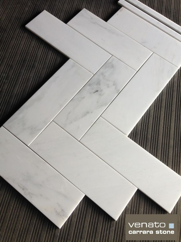"Carrara Venato 4x12"" Tile.  Can be installed in a Herringbone format or running brick format.  Only $8.00 a square foot.  Available online from The Builder Depot."