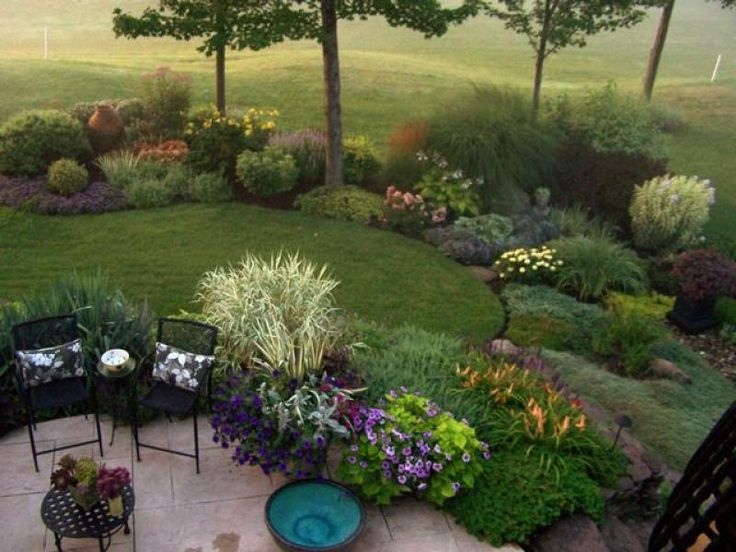 Golf Course Garden: Looking down from my balcony you can see the right side of the garden. The garden is tricky because