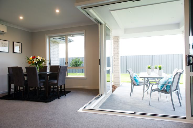 The glass sliders open a complete corner of the home onto the covered alfresco area, creating a large space for entertaining!