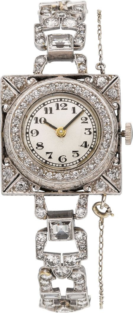 Art Deco Swiss Lady's Diamond, Platinum Wristwatch Case: 20 mm x 20 mm, pierced platinum having European-cut diamond accents, bezel framed by single-cut diamonds Dial: silvered with black Arabic numerals, black baton hand hour and minute hands, mineral crystal Movement: unadjusted 6 jewel quartz
