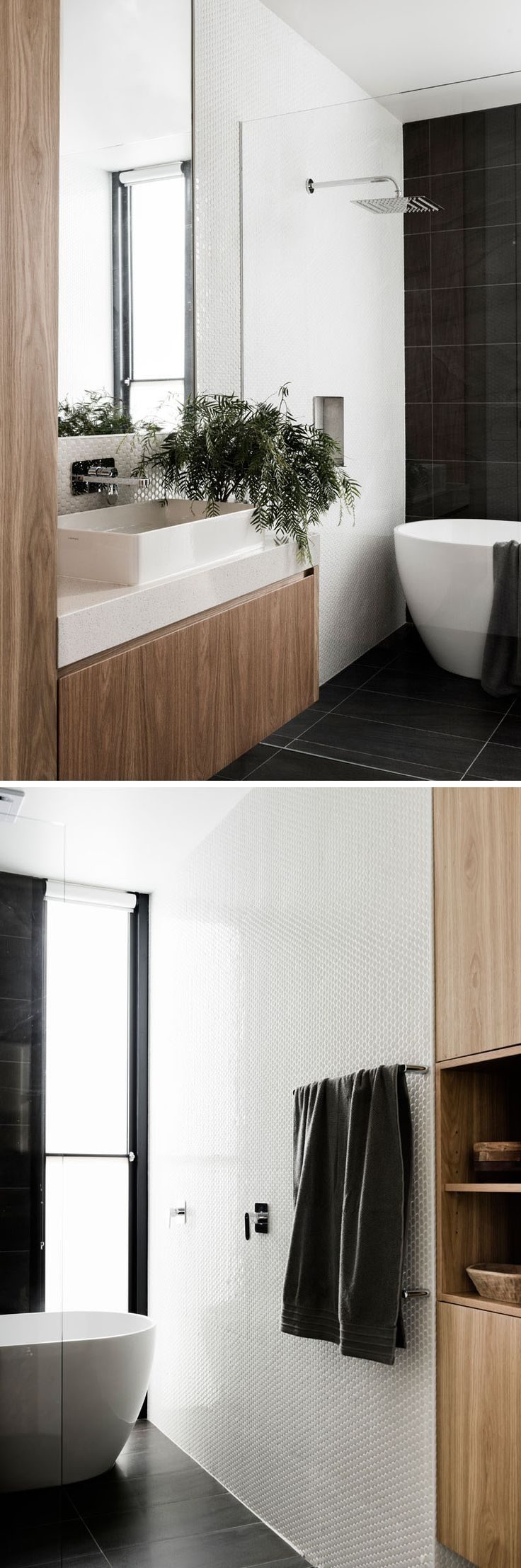 In this modern bathroom, large dark tiles have been paired with small white tiles and touches of wood to create a contemporary look.