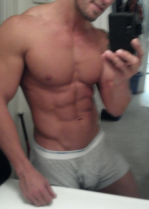 Shirtless muscle stud in boxer briefs in the bathroom shows off his body.