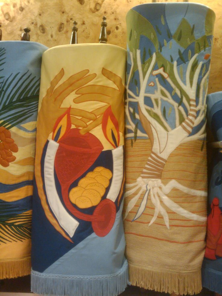 Close-up of the wine, light and tree of life mantles designed by Alison Shearman