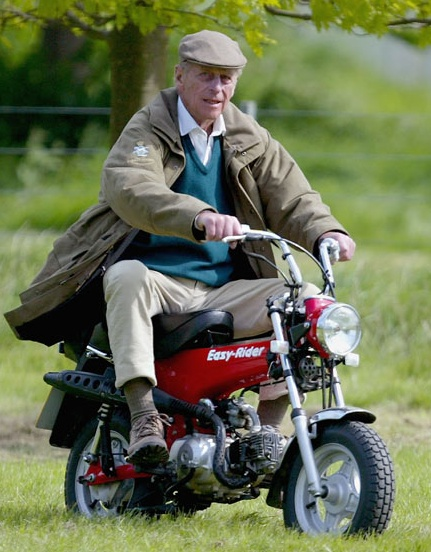 13 May The Duke Of Edinburgh Rides On A Mini Motorbike During Royal Windsor Horse Show At Home Park Castle