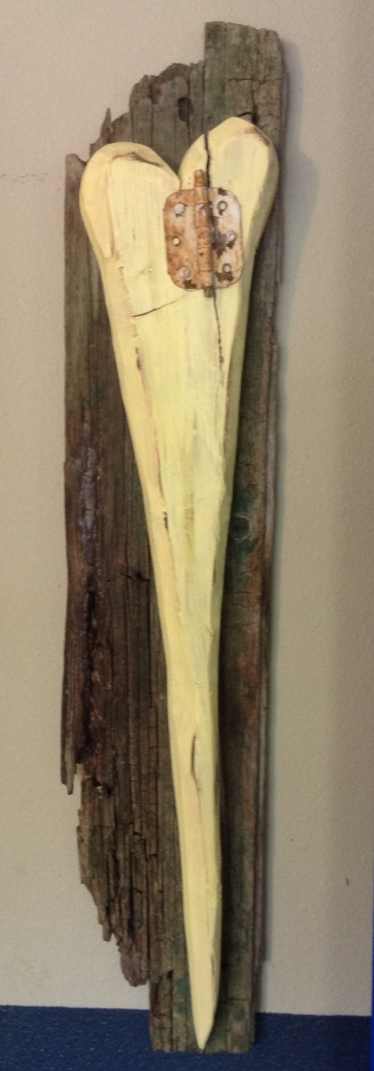 Mended Heart. Created by wife, handcrafted by husband. Mounted on rescued wood.