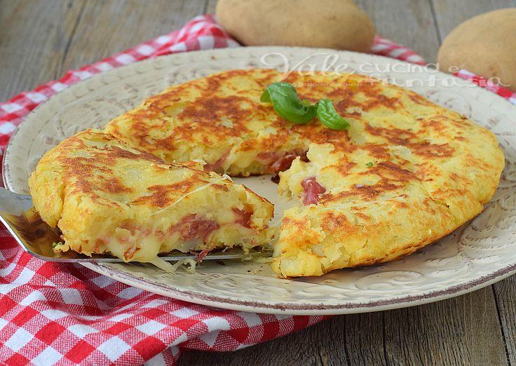 Pizza di patate con prosciutto crudo e fontina, una ricetta a base di patate, buona facile,veloce e gustosa, poca spesa e tanta resa