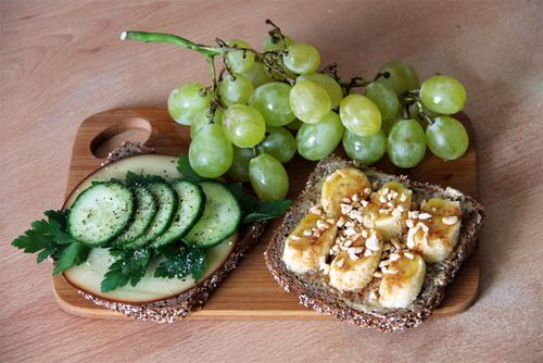 gaintheirjealousy:    Breakfast: Grapes and whole grain bread with pesto, cheese, parsley and cucumber; peanut butter, banana, honey, cinnamon and shredded peanuts