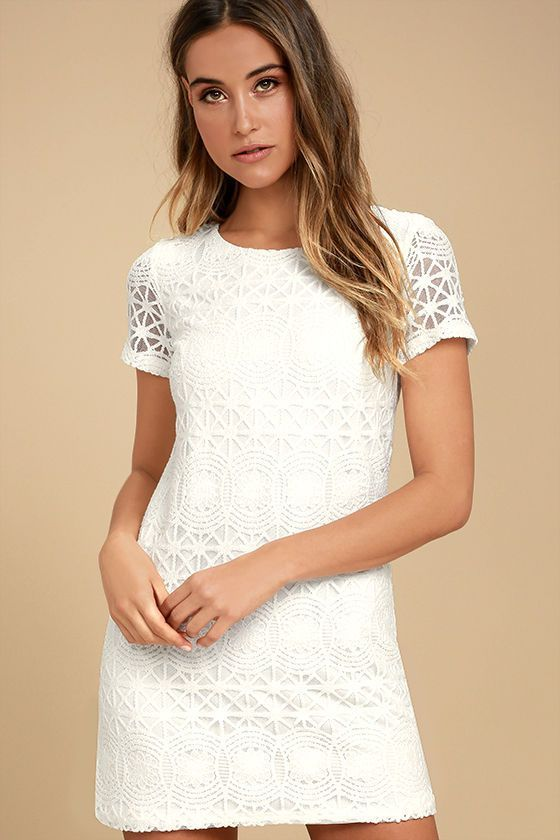 The Love You For Eternity White Lace Shift Dress is always on our minds! Lovely lace and mesh shapes a rounded neckline atop a darted bodice with short sleeves. The shift silhouette falls into a flirty, leg-baring length. Exposed gold back zipper.