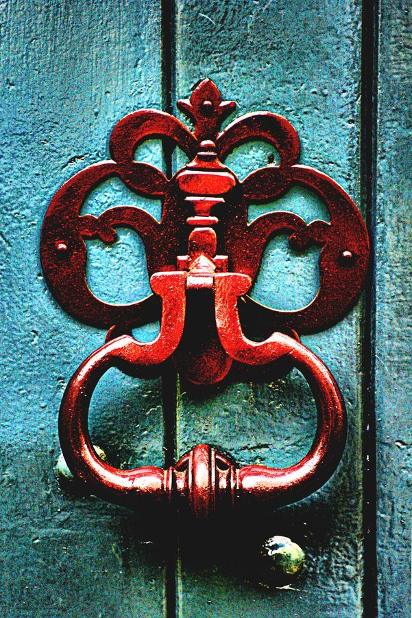 red door knocker on aqua wooden door