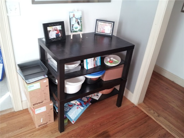 Great idea to stack two Lack coffee tables to make a useful work table.   I like this IKEA Hacker site.