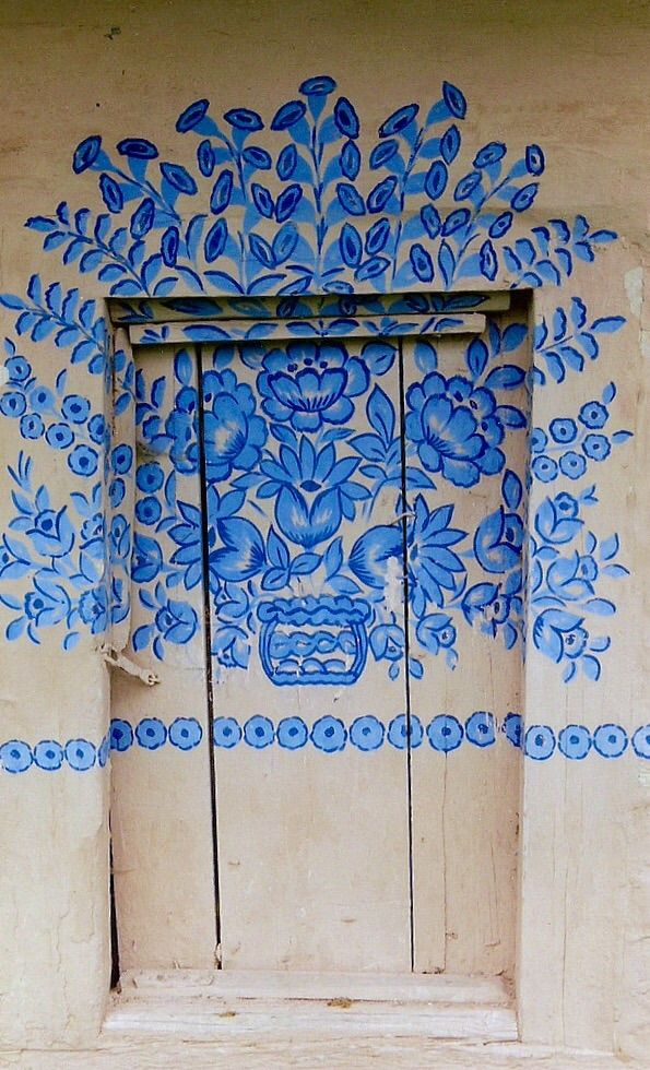 Love this door with blue design in Zalipie, Poland ♥ Stunning, classic jewelry: www.bluedivadesigns.com #bluedivagal
