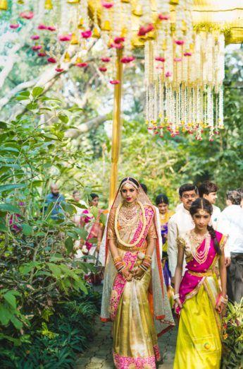 Pink and gold kanjeevaram saree pattu saree on Telugu bride from Tulsi Silks >S ee more on wedmegood.com