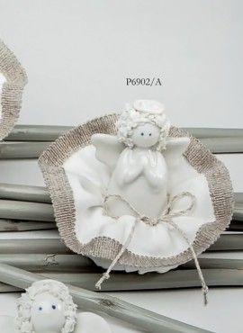 Angioletto riccio porcellana bomboniera romantica e moderna. L'angioletto è simbolo di buona fortuna e rimane un classico.