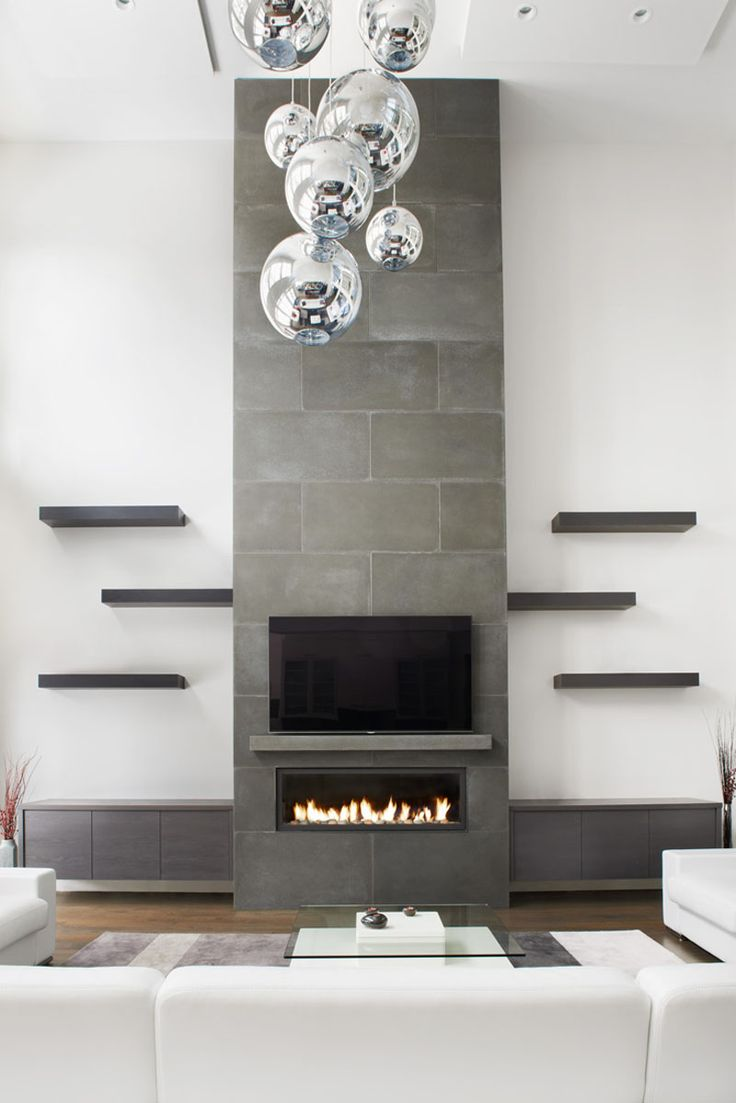 Fireplace Design Idea - 6 Different Materials To Use For A Fireplace Surround // This concrete fireplace surround draws your eye and provides a place to mount your tv.