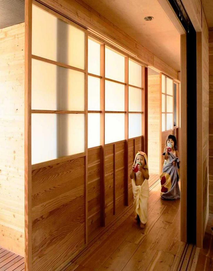 Japanese shoji style screens allow the light from the courtyard to come through the bathroom and into the hallway, courtyard house, studio junction, toronto