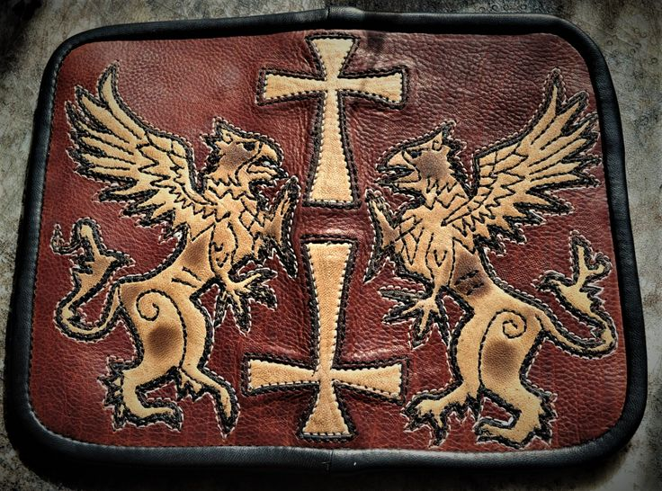 Premium leather Gothic Cross Griffin Wallet designed and crafted by me, www.eddiebratleather.com. I make each piece from start to finish from high end leather, no fillers in any of my pieces. No mass production. Be an individual and not follow the crowd, but stand out in the crowd. Cheers, Eddie